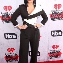 Demi Lovato wears Alexander McQueen and Prada shoes.