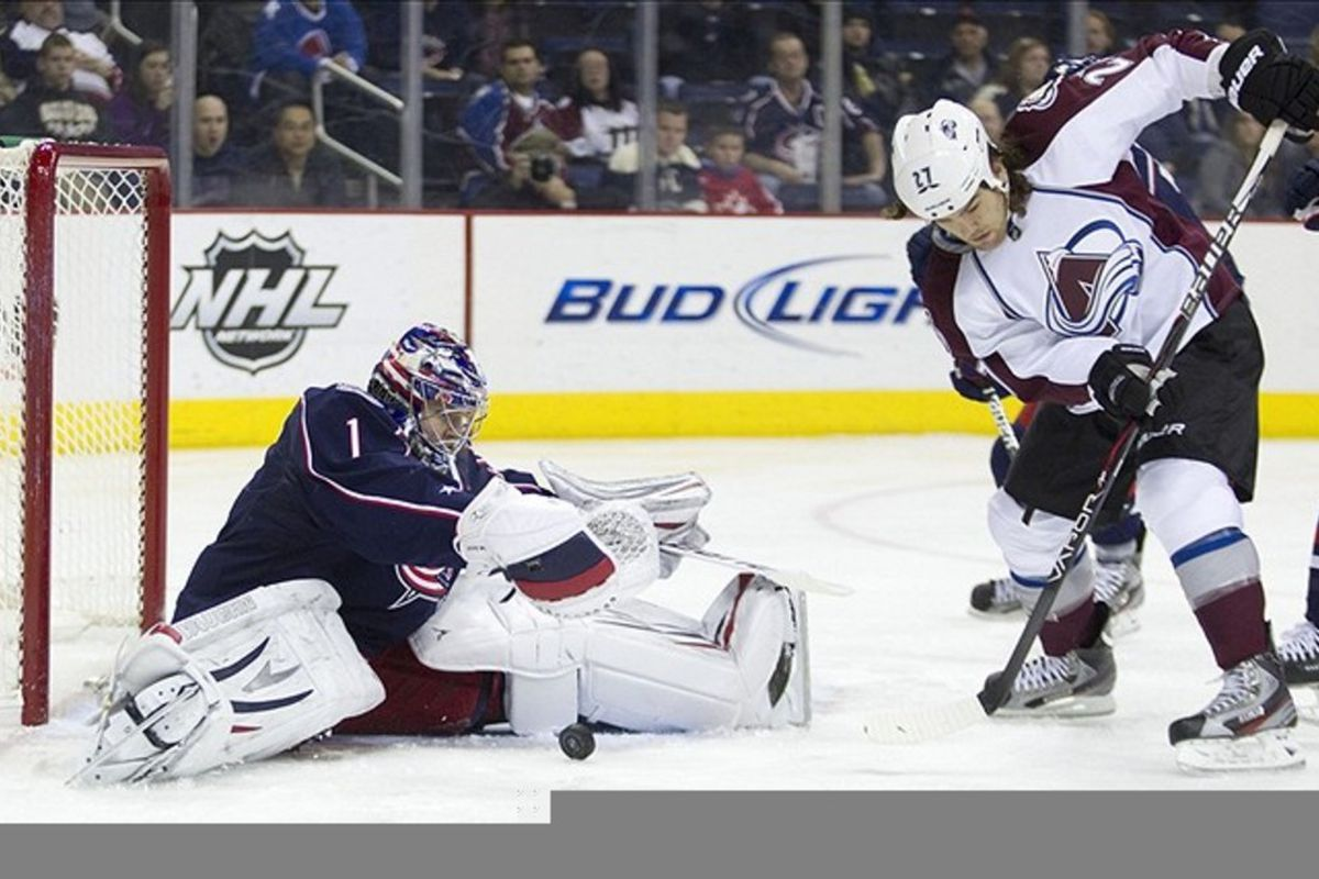 February 24, 2012; Columbus, OH, USA; Columbus Blue Jackets goalie Steve Mason (1) makes a save on Colorado Avalanche right wing Steve Downie (27) at Nationwide Arena.  Mandatory Credit: Greg Bartram-US PRESSWIRE