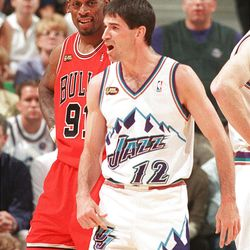 John Stockton complains to the ref as Dennis Rodman smiles during Game 6 of the NBA Finals at the Delta Center, June 14, 1998.