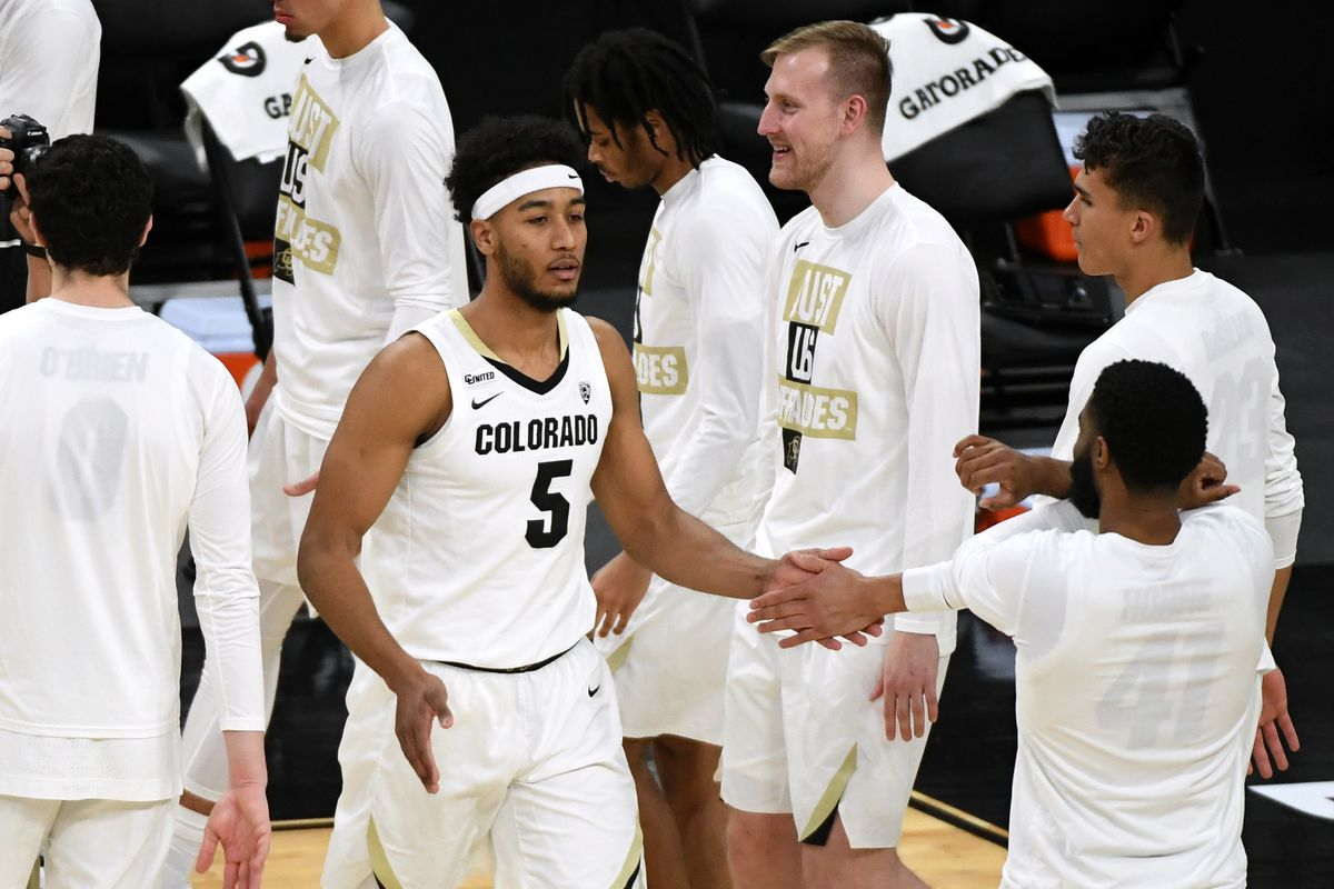 D'Shawn Schwartz #5 of the Colorado Buffaloes is introduced before the championship game of the Pac-12 Conference basketball tournament against the Oregon State Beavers at T-Mobile Arena on March 13, 2021 in Las Vegas, Nevada. The Beavers defeated the Buffaloes 70-68.