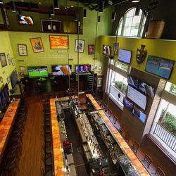 """Looking down on the bar at Tilted Kilt. To the left, the Captain's Table, the most coveted places to sit. <span class=""""credit""""><em>[Photos: <a href=""""http://www.jennadosch.com/"""">Jenna Dosch</a>]</em></span>"""