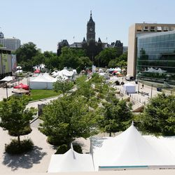 Artists work to get set up for the Utah Arts Festival in Salt Lake City's Library Square on Wednesday, June 21, 2017.