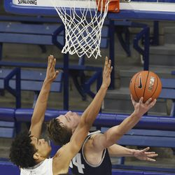 Air Force's Nikc Jackson is unable to keep Utah State's Justin Bean from scoring during the second half of an NCAA college basketball game Thursday, Dec. 31, 2020, at Air Force Academy, Colo.