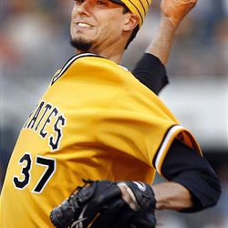 Pittsburgh Pirates' Charlie Morton pitches against the Cincinnati Reds in the second inning of the baseball game in Pittsburgh,  Friday.
