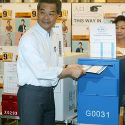 Hong Kong Chief Executive Leung Chun-ying, left and his wife Regina vote at a polling station for the legislative council election in Hong Kong, Sunday, Sept. 9, 2012. Hong Kong voters cast their ballots Sunday in legislative council elections that will see them choosing more than half the seats for the first time. Voters are selecting 40 representatives while 30 others are chosen by business and special interest groups. In previous votes, it was evenly split but 10 new seats have been added this time.