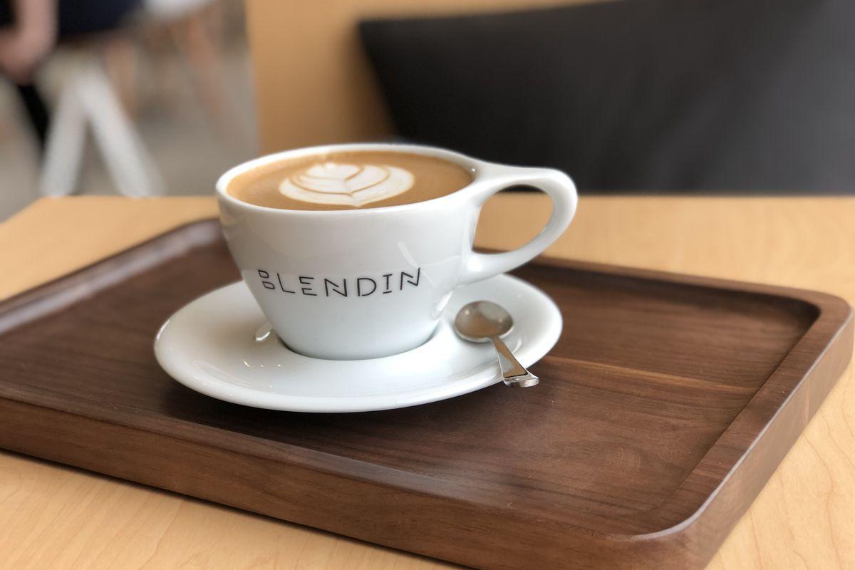 a demi-tasse cup full of foamy coffee