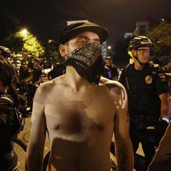 Occupy Demonstrators march at night, Wednesday, Sept. 5, 2012, in Charlotte, N.C., during the second day of the Democratic National Convention.