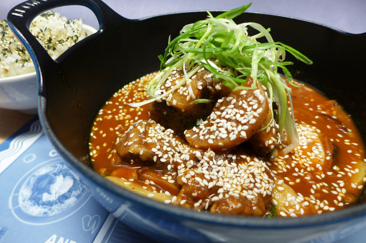 Spicy oxtail with rice cakes and daikon