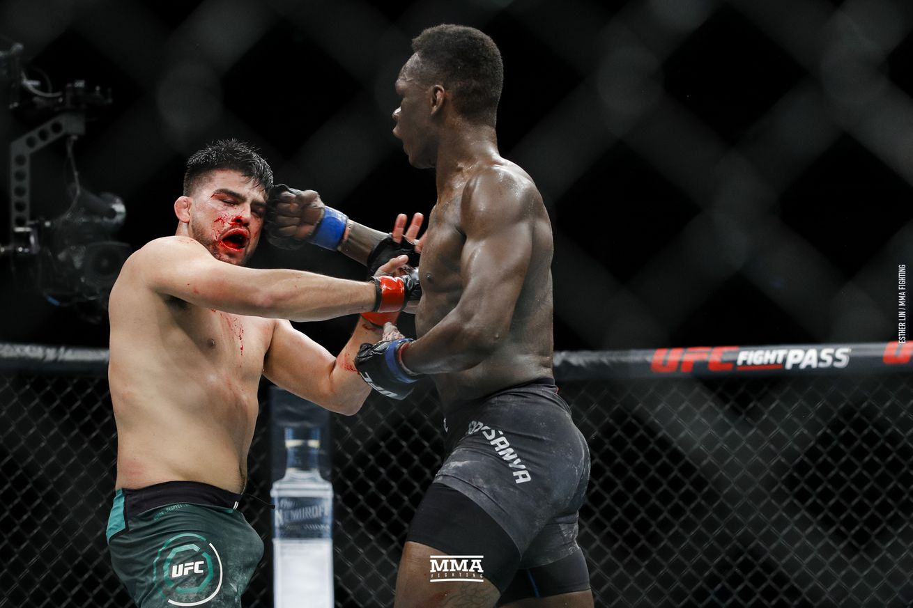 Kelvin Gastelum and Israel Adesanya in action at UFC 236 on Saturday in Atlanta