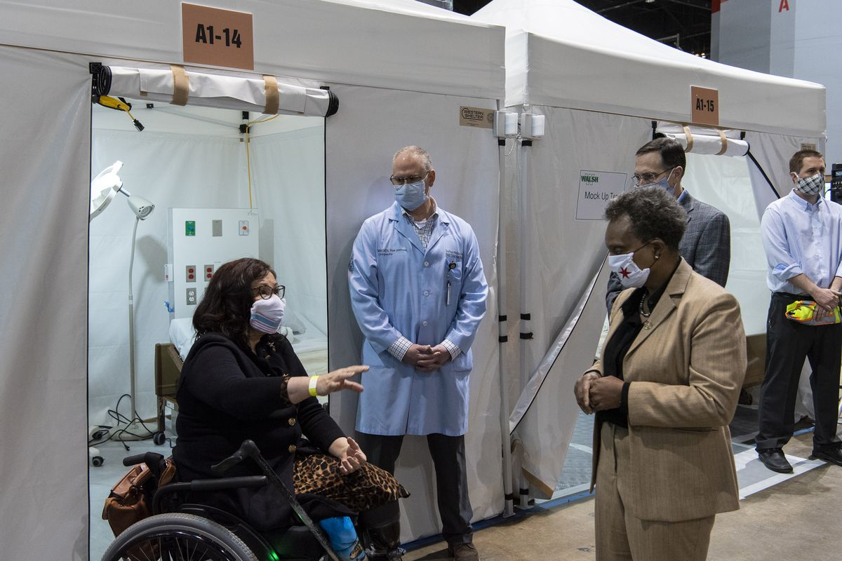 U.S. Sen. Tammy Duckworth (left) and Mayor Lori Lightfoot touring the COVID-19 field hospital at McCormick Place on April 17.