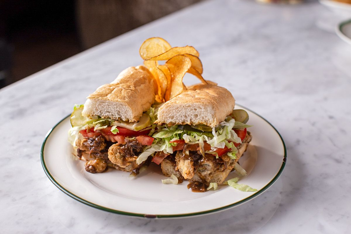 A Peacemaker po' boy tops fried oysters with a braised beef cheek gravy