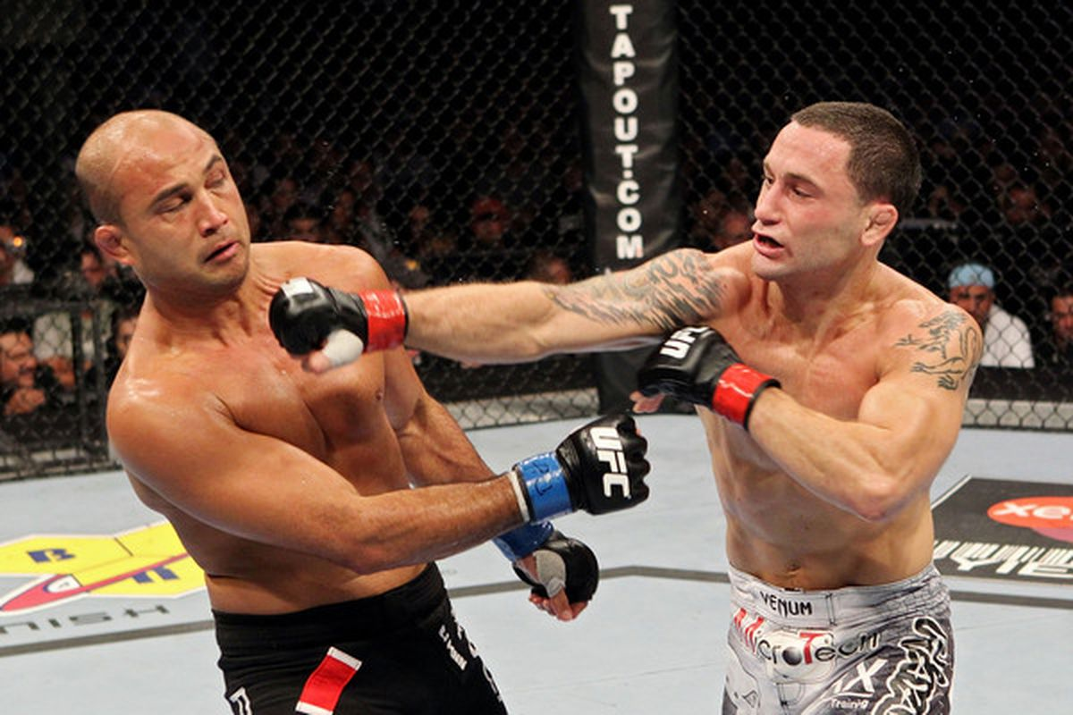 BOSTON - AUGUST 28:   Frank Edgar (R) connects with a punch to the face of BJ Penn during their UFC 118 lightweight title bout at the TD Garden on August 28 2010 in Boston Massachusetts.  (Photo by Josh Hedges/Zuffa LLC/Zuffa LLC via Getty Images)