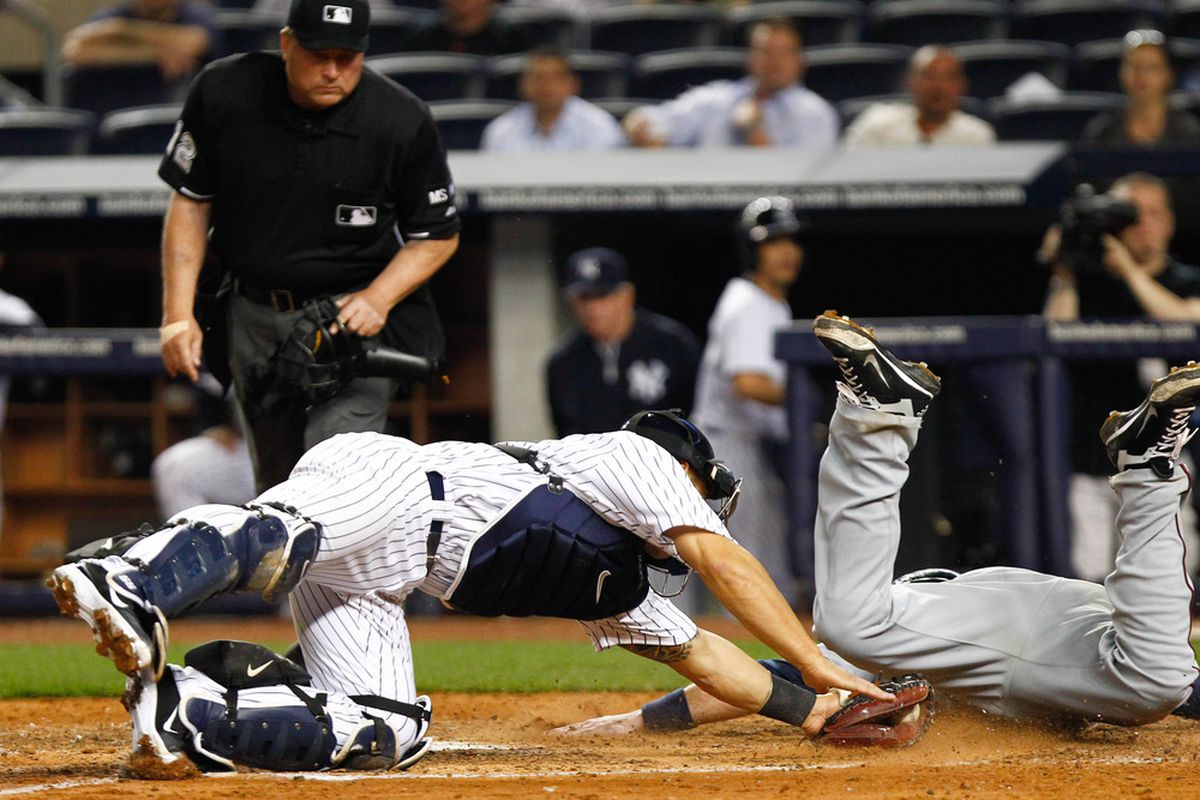 Ryan Doumit slides around Russell Martin's tag in the seventh inning last night, extending the Twins lead yet again. But he does not make today's poll.