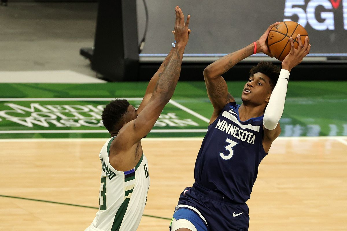 Jaden McDaniels of the Minnesota Timberwolves shoots over Thanasis Antetokounmpo of the Milwaukee Bucks during the first half of a game at Fiserv Forum on February 23, 2021 in Milwaukee, Wisconsin.