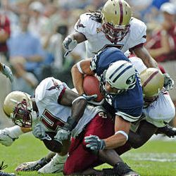 BYU tight end Jonny Harline is taken down by Boston College's Jazzmen Williams, left, Larry Anam, center, and Mathias Kiwanuka during the Cougars' 20-3 home loss Saturday.