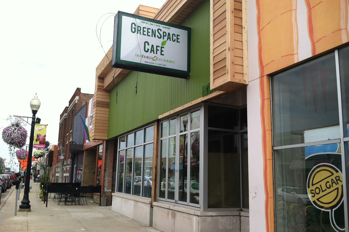 Faux grass now covers the facade at GreenSpace Cafe in Ferndale.