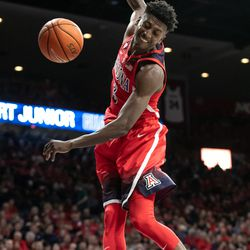 Dylan Smith goes in for a hard slam during the 2018 Red-Blue dunk contest in McKale Center on October 14 in Tucson, Ariz.