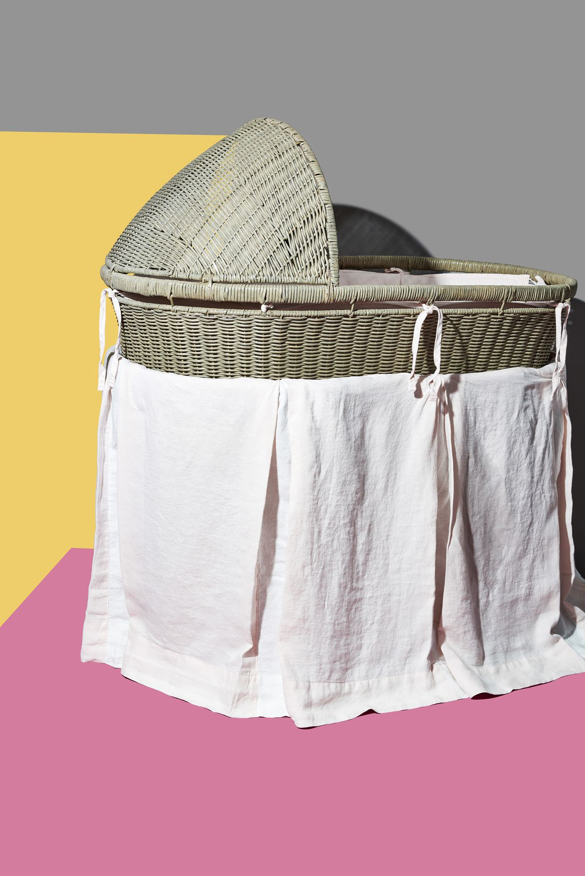 This Rustic Bassinet Fashioned Out Of Woven Wicker Sits On A Base That Includes Storage Shelf Hidden By Washed Linen Skirt Snap Up The