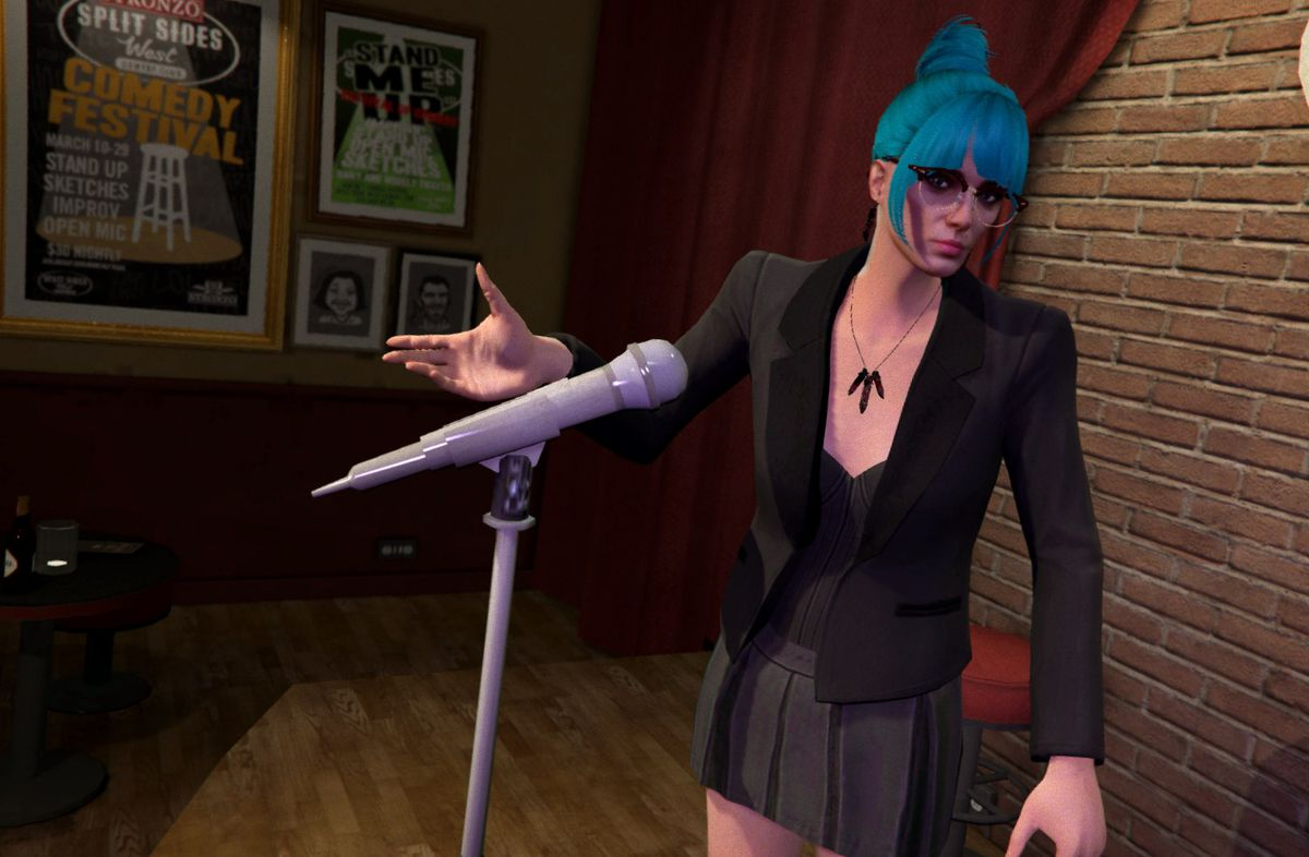 Grand Theft Auto - a woman with blue hair and glasses stands in front of a microphone, gesturing. She is wearing a business suit with a short skirt and dangling earrings.