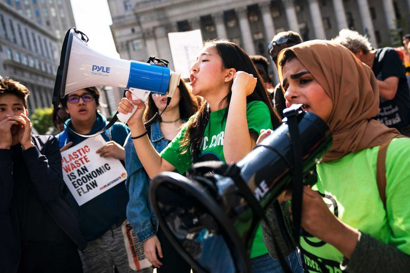 Global Climate Strike protesters speak into bullhorns.