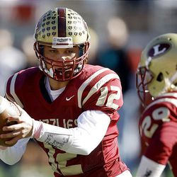Quarterback DJ Nelson spins and hands the ball off to #29 John Schmidt as Logan and Bountiful play Thursday, Nov. 10, 2011 in the 4A semifinal game at Rice Eccles stadium in Salt Lake City. Logan won 59-30.