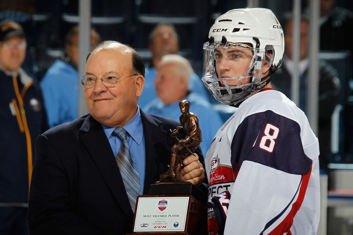 Ryan Fitzgerald collects his MVP trophy from Scotty Bowman following the All-American Prospects Game.