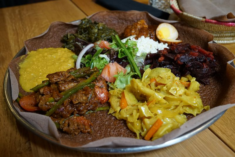 """The """"chef's selection"""" messob is served with injera bread at Demera restaurant in Uptown."""