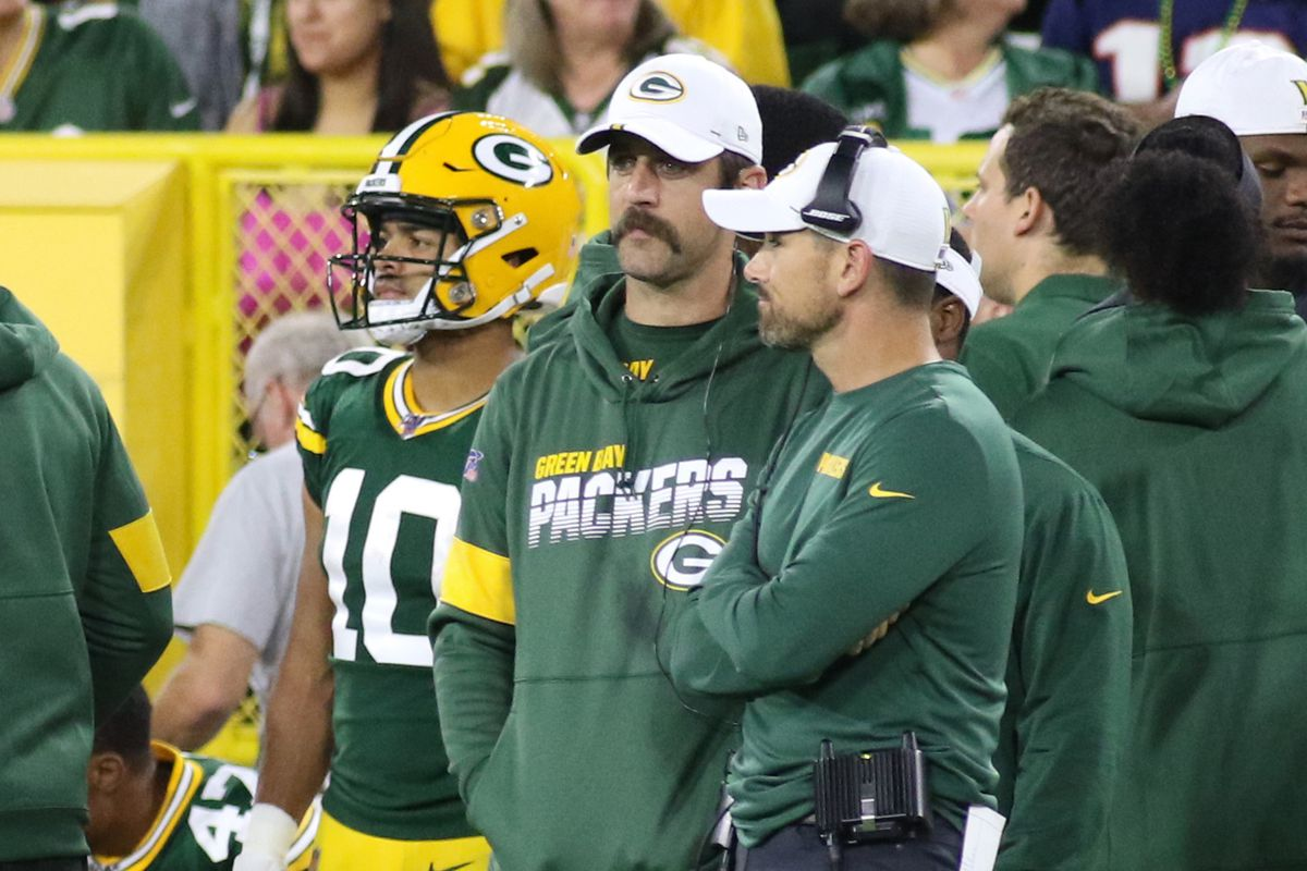 Green Bay Packers quarterback Aaron Rodgers talks with Green Bay Packers head coach Matt LaFleur during a game between the Green Bay Packers and the Kansas City Chiefs at Lambeau Field on August 29, 2019 in Green Bay, WI.