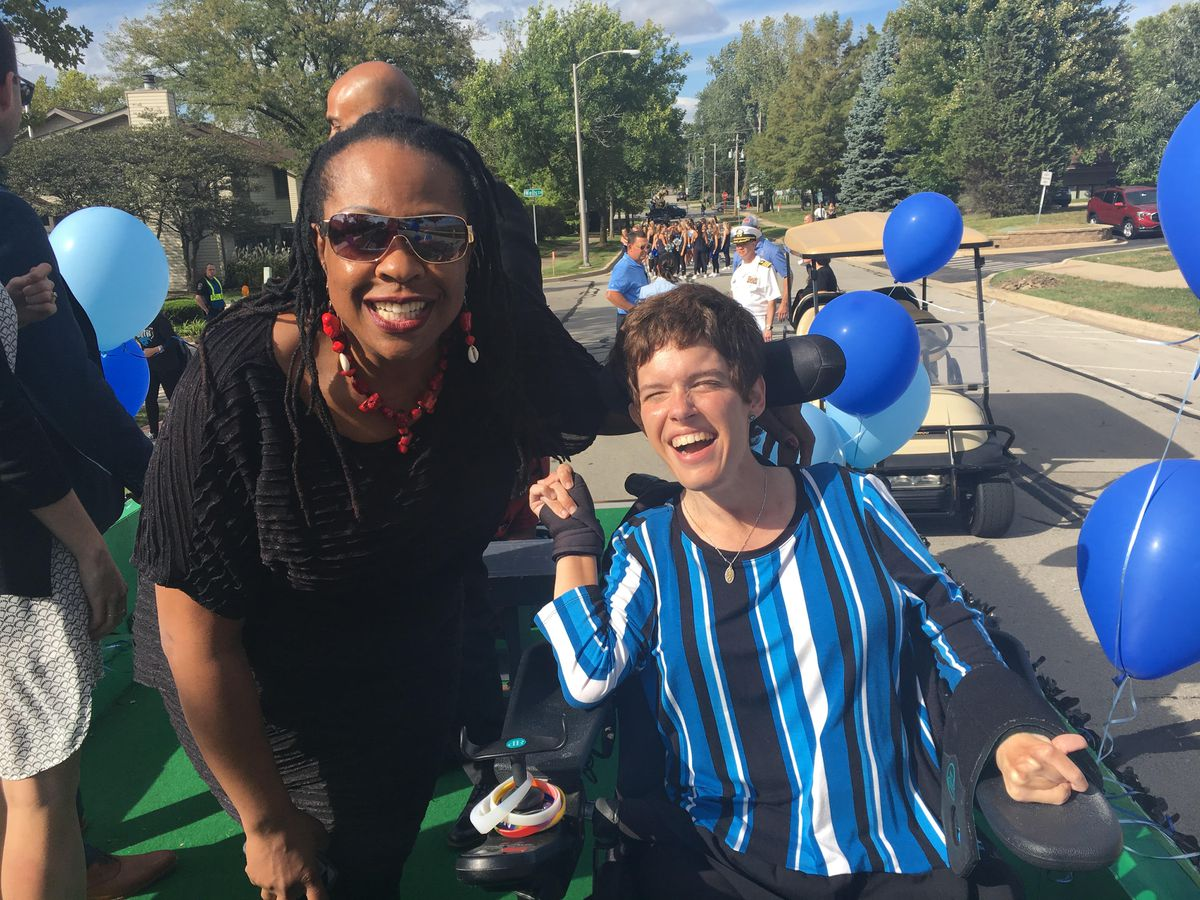 Sun-Times reporter Maudlyne Ihejirika with Amy Liss and three fellow inductees were honored with riding a Distinguished Alumni Wall of Fame float in the Downers Grove South homecoming parade.   Provided/Liss Family