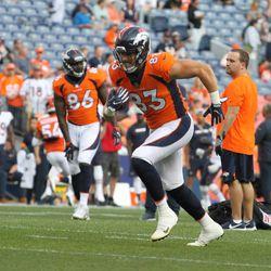Broncos TE Matt LaCosse carries the ball during pregame warmups.