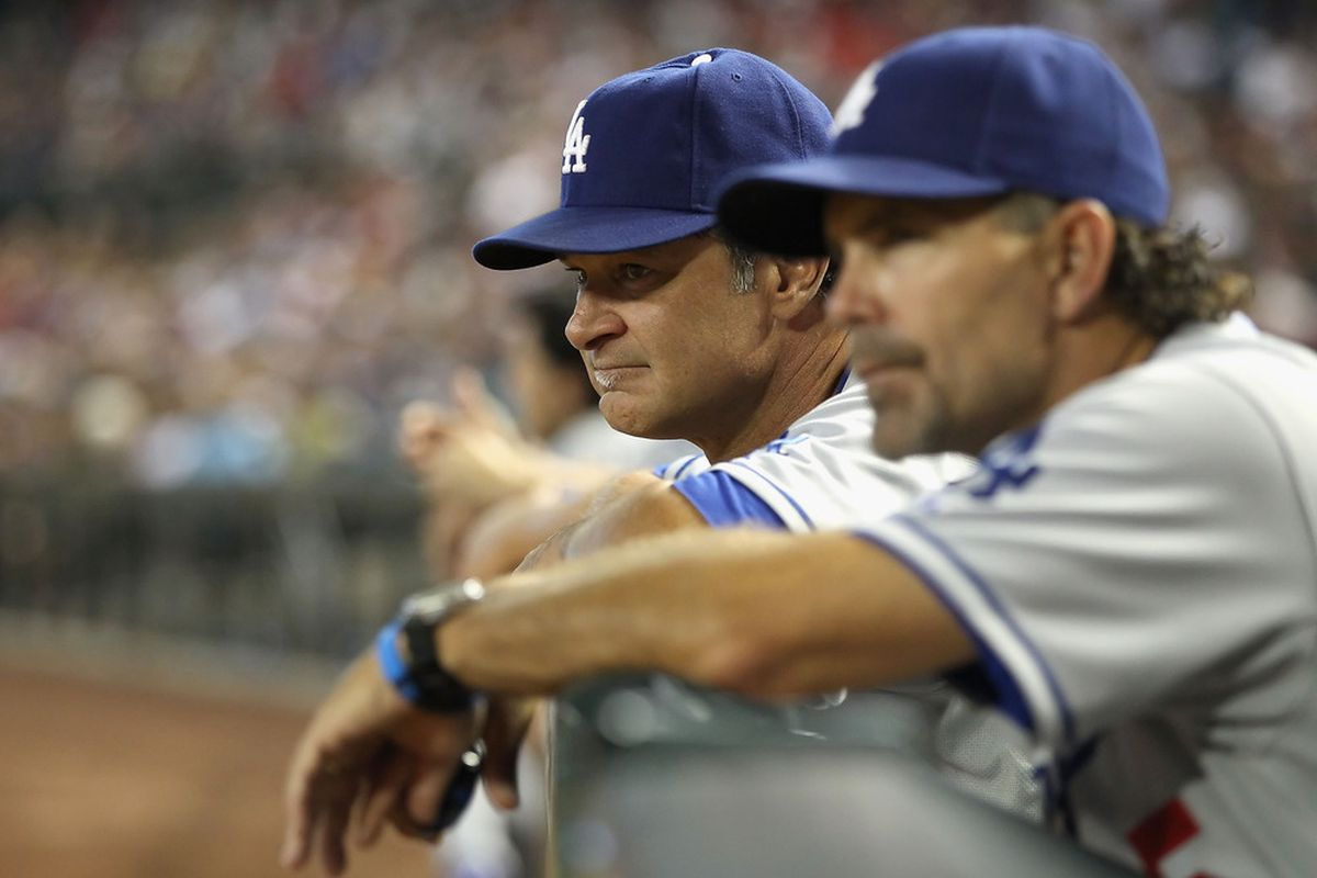 PHOENIX, AZ -   Manager Don Mattingly of the Los Angeles Dodgers watches from the dugout during the Major League Baseball game against the Arizona Diamondbacks. (Photo by Christian Petersen/Getty Images)