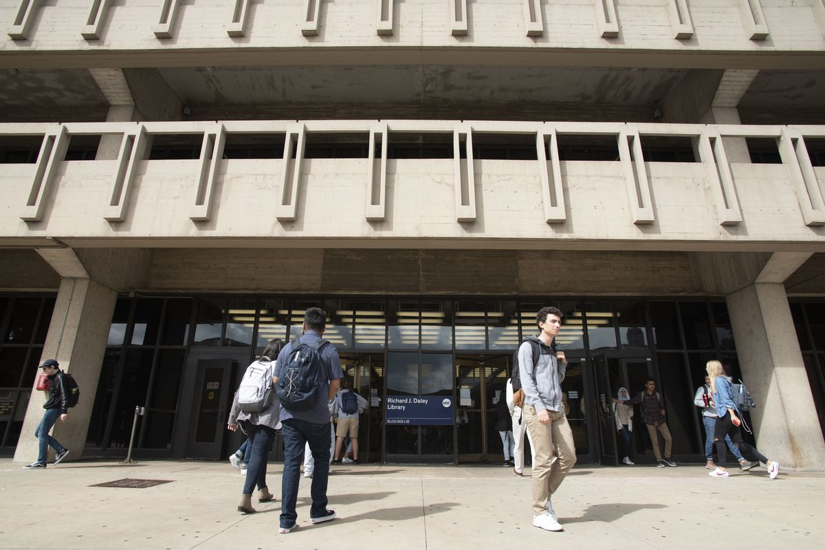 Students walk through the campus of the University of Illinois at Chicago. Gov. J.B. Pritzker has not ruled out a COVID-19 vaccination requirement for students returning to public universities this fall.