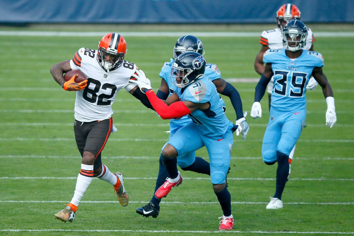 Rashard Higgins #82 of the Cleveland Browns carries the ball after making a reception against Kevin Byard #31 of the Tennessee Titans in the first quarter at Nissan Stadium on December 06, 2020 in Nashville, Tennessee.