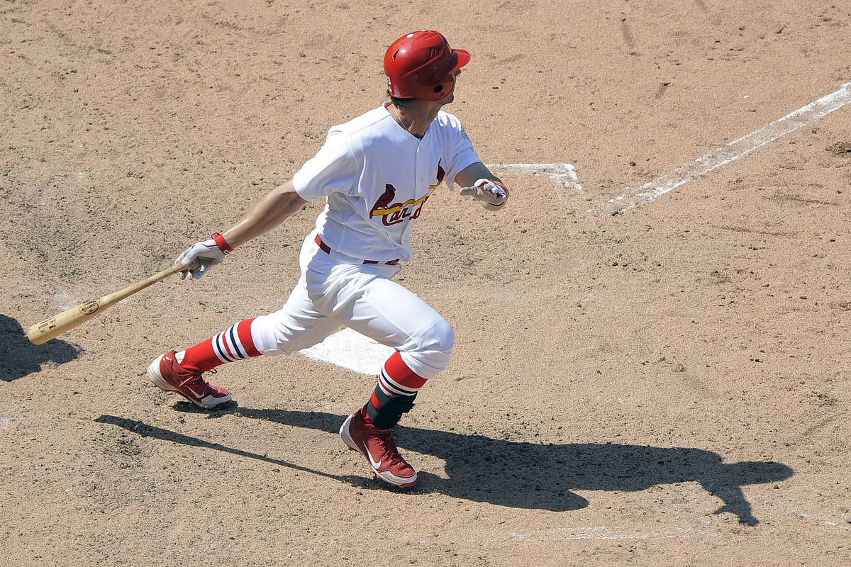 July 22, 2012; St. Louis, MO. USA; St. Louis Cardinals shortstop Daniel Descalso (33) hits a single in the eighth inning against the Chicago Cubs at Busch Stadium. The Cardinals won 7-0. Mandatory Credit: Jeff Curry-US PRESSWIRE