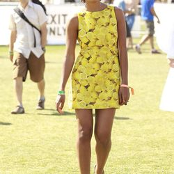 Musician Solange Knowles looking adorably fresh in a lemony dress by Alice + Olivia.