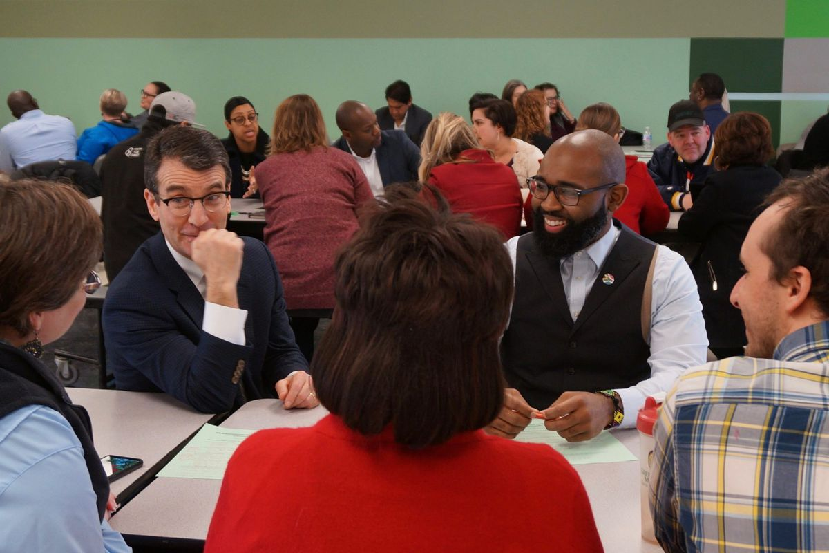 School board president Michael O'Connor, left, and IPS graduate Darius Sawyers at a community meeting about the district's next superintendent.
