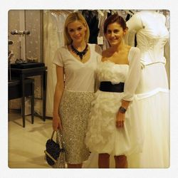 """Racked <a href=""""http://la.racked.com/archives/2011/12/19/jaime_king_is_officially_our_new_la_shopping_buddy.php"""">pal</a> Jamie King and stylist/DJ Nikki Penne toast the new David's Bridal store in West Hollywood."""