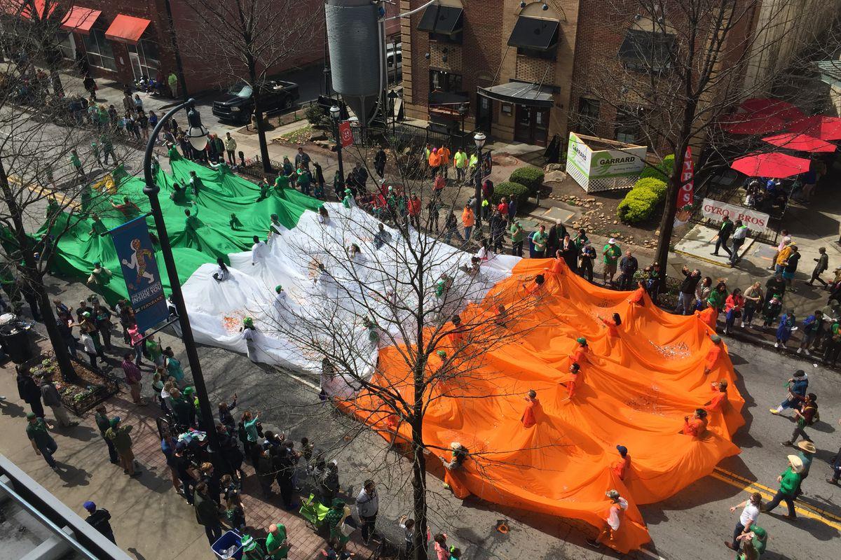 Photo of a A massive Irish flag closed out the parade.