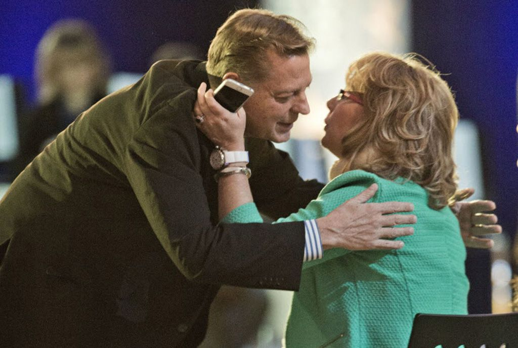 The Rev. Michael Pfleger, pastor at St. Sabina Catholic Church in Chicago, greets former U.S. Rep. Gabby Giffords, D-Ariz., at President Barack Obama's televised town hall meeting. | Pablo Martinez Monsivais/AP
