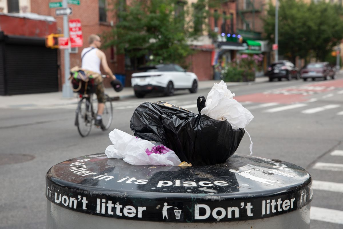 Plastic bags overflow from a Brooklyn garbage bin more than a year after they were banned, July 22, 2021.