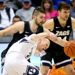 Brigham Young Cougars guard TJ Haws (30) and Gonzaga Bulldogs forward Killian Tillie (33) compete for the ball at the Marriott Center in Provo on Saturday, Feb. 22, 2020.