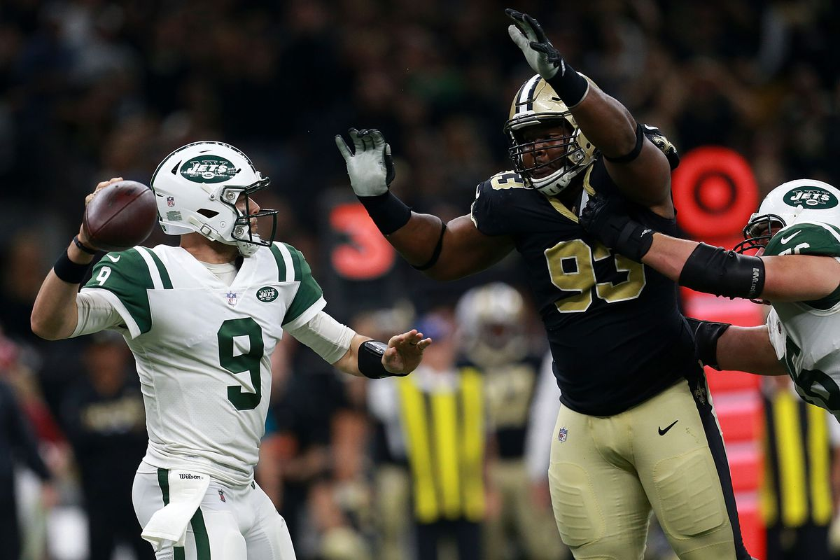NEW ORLEANS, LA - Quarterback Bryce Petty #9 of the New  York Jets is pressured by defensive tackle David Onyemata #93 of the New  Orleans Saints during the first half of a game at the Mercedes-Benz  Superdome.