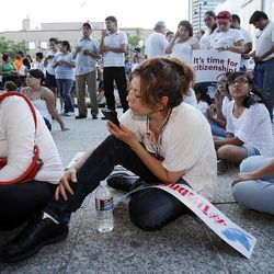 Silvia, Azucena and Maribel Zuazo telephone U. S. representatives during a prayer vigil for immigration reform in Salt Lake City, Thursday, June 27, 2013.