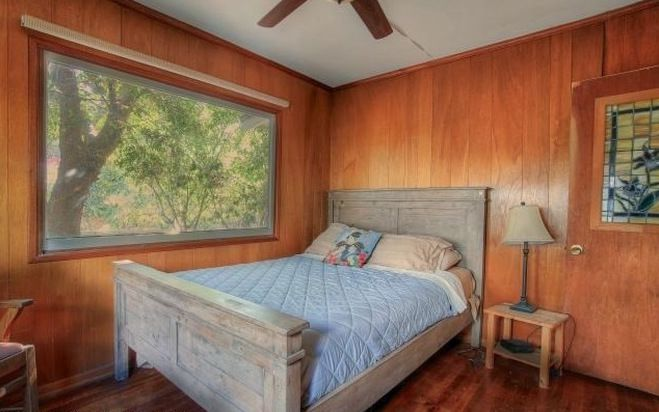 Bedroom with woodsy view