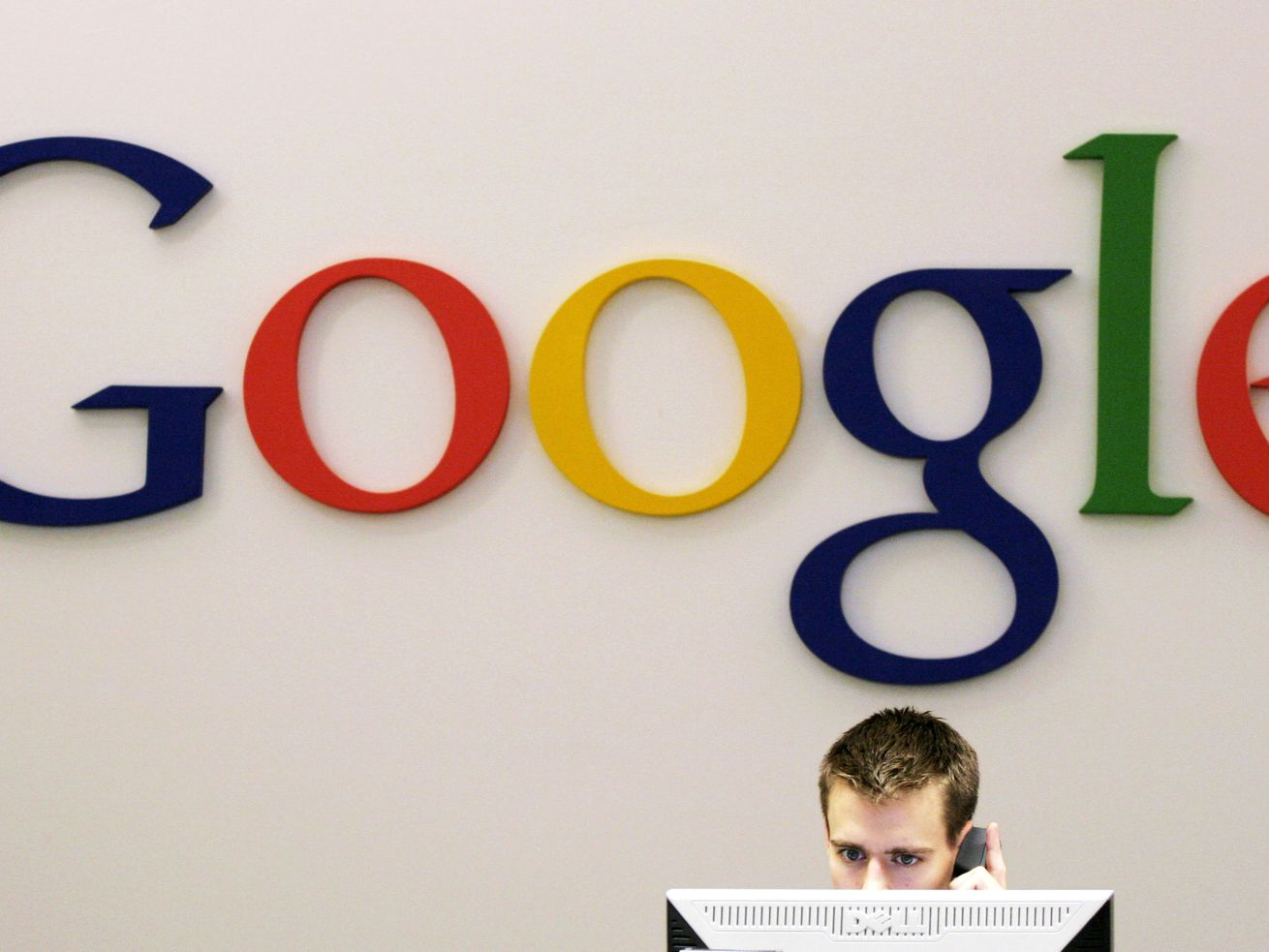 """In this Oct. 2, 2006 file photo, a Google receptionist works at the front desk in the company's office in New York. Australia announced a police investigation Sunday, June 6, 2010 into whether Google illegally collected private information from wireless networks, becoming at least the second country to probe the Internet giant's """"Street View"""" mapping service. (AP Photo/Mark Lennihan, File)"""