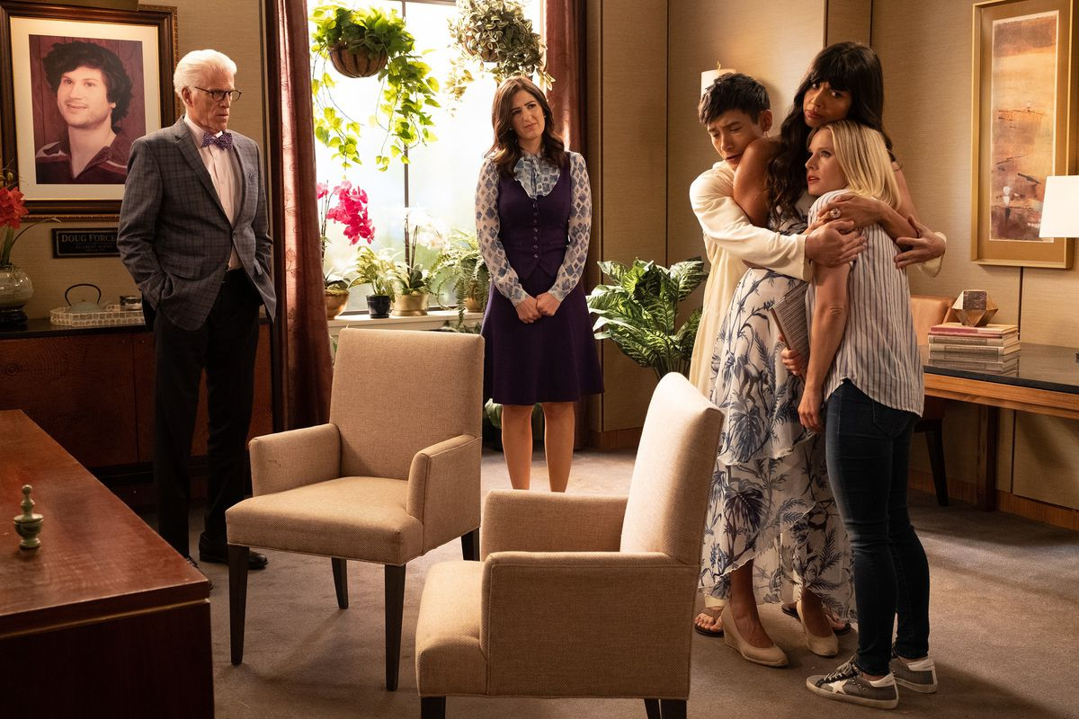 the cast of the good place hugs