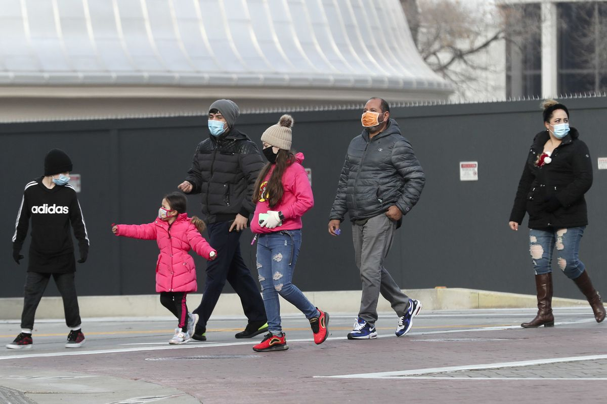 Pedestrians wear masks as they walk in downtown Salt Lake City on Monday, Nov. 23, 2020.