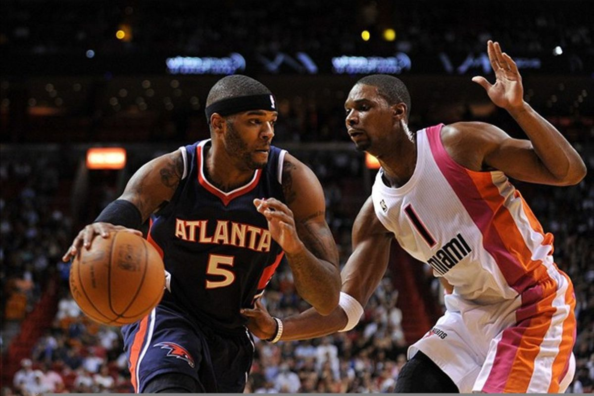 March 7, 2012; Miami, FL, USA; Atlanta Hawks power forward Josh Smith (5) drives against Miami Heat power forward Chris Bosh (1) during the first half at American Airlines Arena. Mandatory Credit: Steve Mitchell-US PRESSWIRE