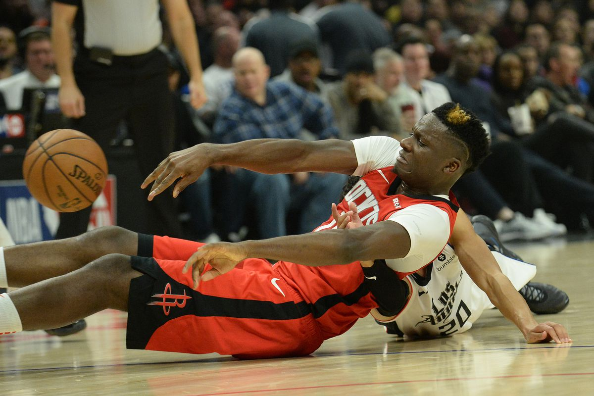 Houston Rockets center Clint Capela passes the ball after recovering it against Los Angeles Clippers guard Landry Shamet during the first half at Staples Center.