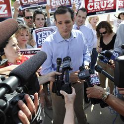 Former Texas Solicitor General Ted Cruz, center, is surrounded by supporters and media at a voting precinct Tuesday, July 31, 2012, in Houston. Cruz faces Lt. Gov. David Dewhurst in the Republican primary runoff election for the Republican nomination for the U.S. Senate.